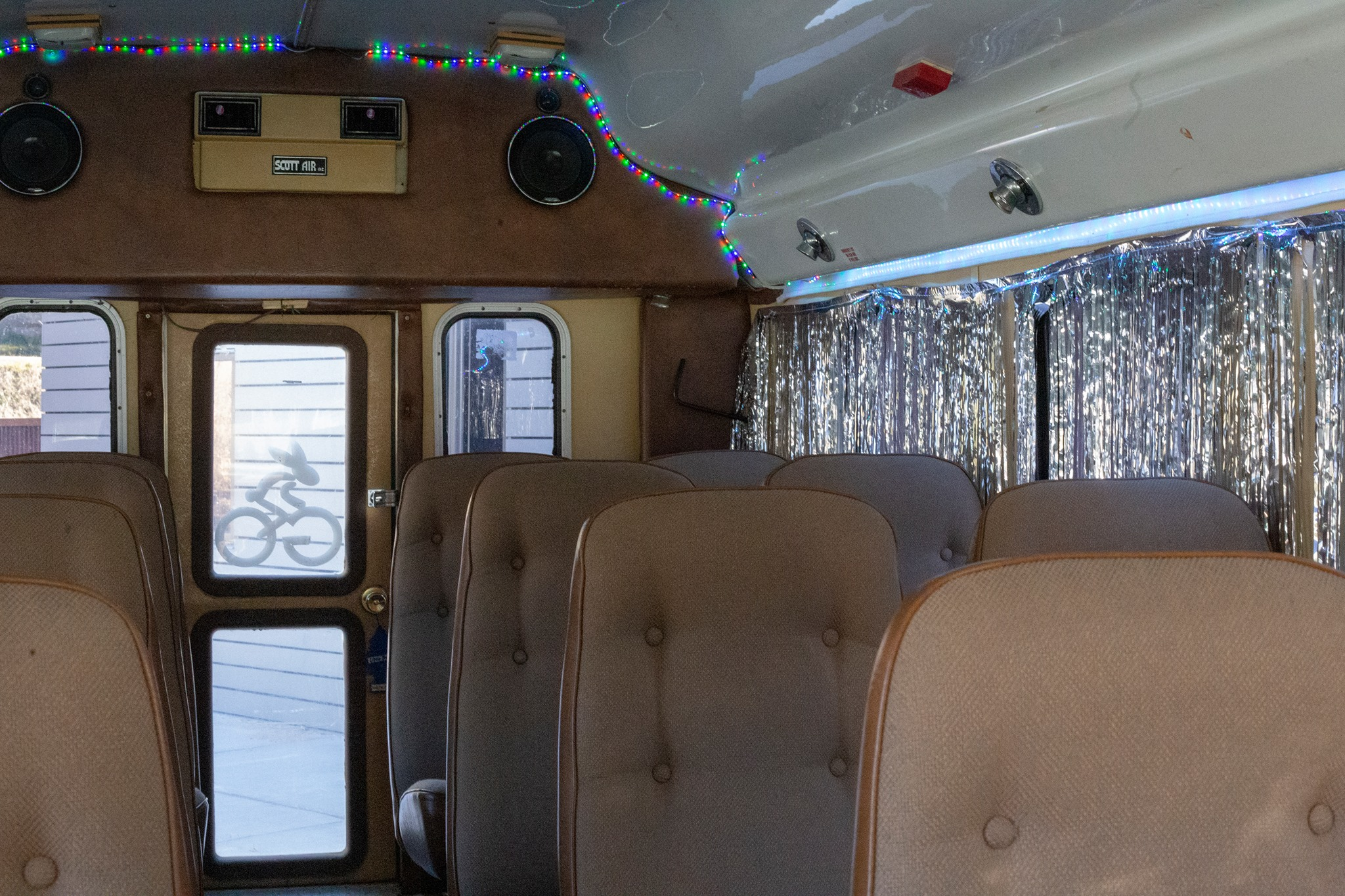 Another bus interior with blue LED lights and comfortable brown leather seating.