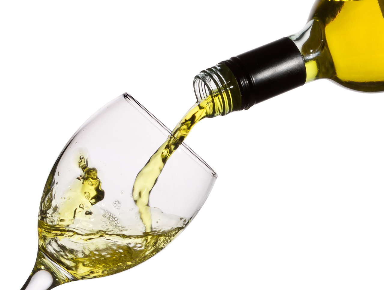 White wine being artfully poured into a glass